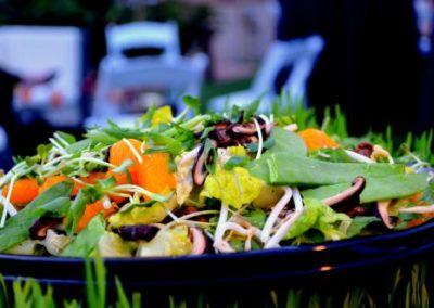 Fresh Asian salad with greens and cabbage and carrots.