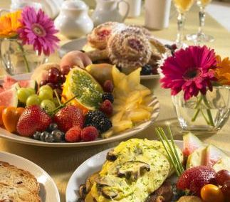 Breakfast buffet catering with fresh fruits and eggs.