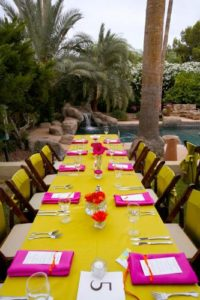 Bright floral lime green tablecloth pink napkins reception tables