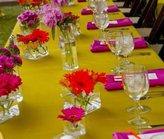 bright floral on lime green table with hot pink napkins