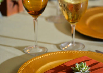 Gold and red themed wedding place setting